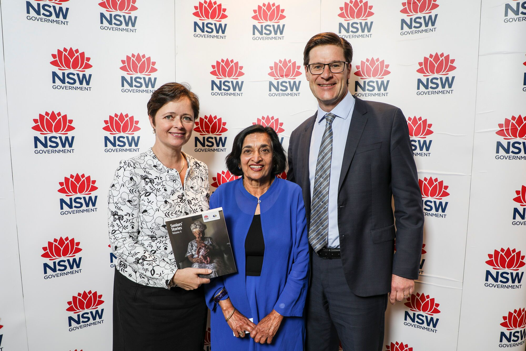 St Ives Local Dr Ramah Juta is congratulated by Minister for Ageing Tanya Davies and Member for Davidson Jonathan O'Dea for her publication in Seniors' Stories Volume 4 at NSW Parliament